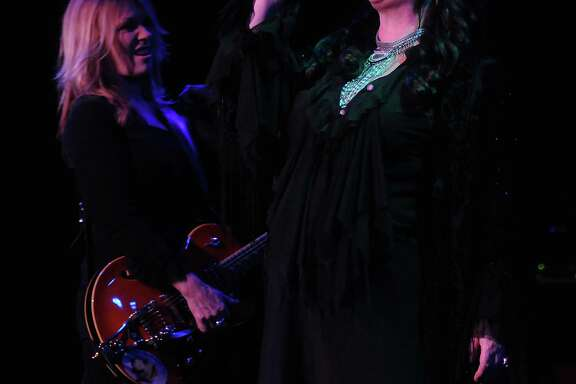 Ann and Nancy Wilson of Heart perform during the band's show at the Stafford Centre on Wednesday. The energetic show demonstrated why the Canadian duo is enjoying a resurgence. Nancy's sprightly energy complements Ann's more thoughtful persona.