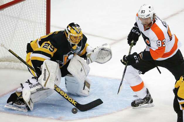 Philadelphia Flyers right wing Jakub Voracek (93) can't get to a rebound in front of Pittsburgh Penguins goalie Marc-Andre Fleury (29) during the first period of an NHL hockey game in Pittsburgh, Wednesday, Oct. 22, 2014. (AP Photo/Gene J. Puskar) ORG XMIT: PAGP109 Photo: Gene J. Puskar / AP