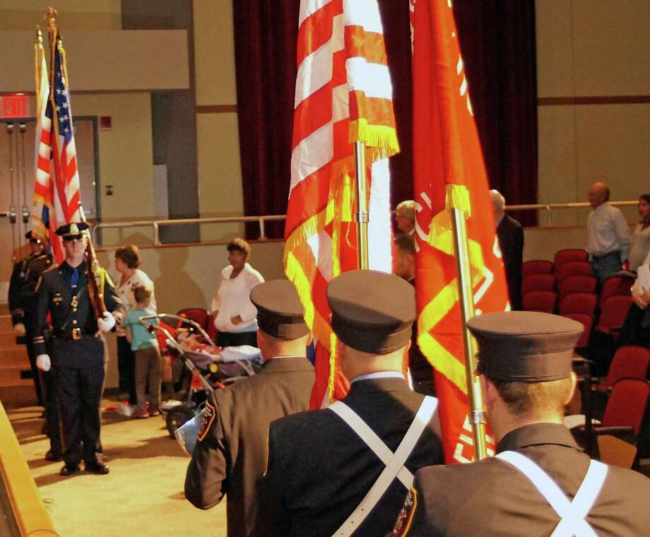 The honor guards from the Police and Fire departments make their way into the Roger Ludlowe Middle School auditorium for the annual Public Safety Awards Wednesday. Photo: Genevieve Reilly / Fairfield Citizen