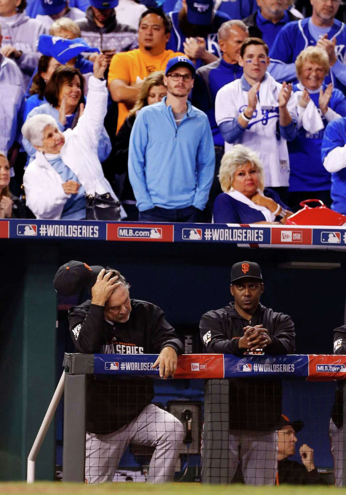 Royals fans celebrate in the beginning of the ninth inning during Game 2 of the World Series at Kauffman Stadium on Wednesday, Oct. 22, 2014 in Kansas City, Mo.
