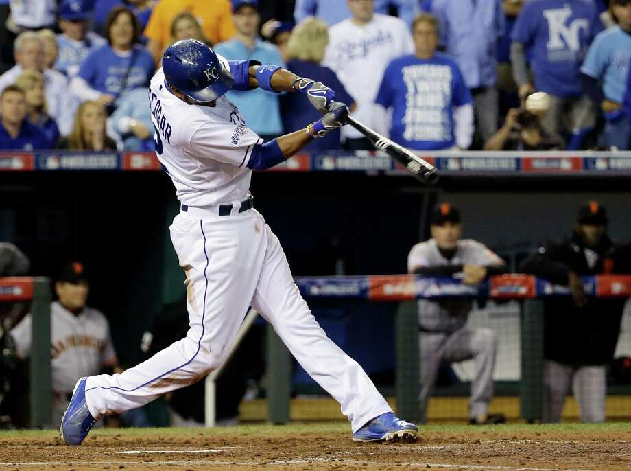 Kansas City Royals' Alcides Escobar hits an RBI double during the second inning of Game 2 of baseball's World Series against the San Francisco Giants Wednesday, Oct. 22, 2014, in Kansas City, Mo. (AP Photo/David J. Phillip)  ORG XMIT: WS139 Photo: David J. Phillip / AP