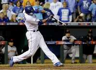 Kansas City Royals' Alcides Escobar hits an RBI double during the second inning of Game 2 of baseball's World Series against the San Francisco Giants Wednesday, Oct. 22, 2014, in Kansas City, Mo. (AP Photo/David J. Phillip)  ORG XMIT: WS139
