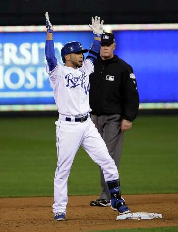 Second base umpire Ted Barrett watches as Kansas City Royals Omar Infante celebrates his double during the second inning of Game 2 of baseball's World Series against the San Francisco Giants, Wednesday, Oct. 22, 2014, in Kansas City, Mo. (AP Photo/Matt Slocum) ORG XMIT: WS340 Photo: Matt Slocum / AP