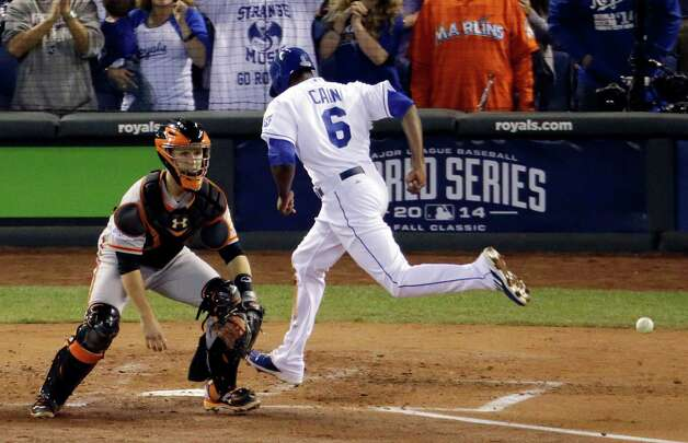 San Francisco Giants catcher Buster Posey waits for the throw as Kansas City Royals' Lorenzo Cain scores from second on a hit by Billy Butler during the first inning of Game 2 of baseball's World Series Wednesday, Oct. 22, 2014, in Kansas City, Mo. (AP Photo/Charlie Riedel)  ORG XMIT: WS134 Photo: Charlie Riedel / AP