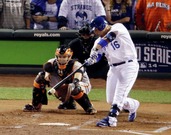 Kansas City Royals' Billy Butler hits an RBI single during the first inning of Game 2 of baseball's World Series against the San Francisco Giants Wednesday, Oct. 22, 2014, in Kansas City, Mo. (AP Photo/Charlie Riedel)  ORG XMIT: WS133 Photo: Charlie Riedel / AP