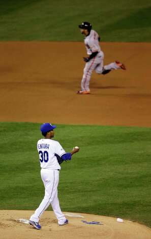 Kansas City Royals pitcher Yordano Ventura looks back as San Francisco Giants' Gregor Blanco rounds the bases after Blanco hit a home run during the first inning of Game 2 of baseball's World Series Wednesday, Oct. 22, 2014, in Kansas City, Mo. (AP Photo/Jeff Roberson)  ORG XMIT: WS124 Photo: Jeff Roberson / AP