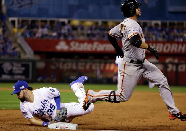 Kansas City Royals' Eric Hosmer (35) dives to first to beat San Francisco Giants' Gregor Blanco to the bag for an out during the third inning of Game 2 of baseball's World Series Wednesday, Oct. 22, 2014, in Kansas City, Mo. (AP Photo/David J. Phillip)  ORG XMIT: WS142 Photo: David J. Phillip / AP