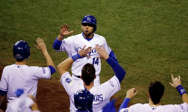 Kansas City Royals' Omar Infante celebrates with teammates after scoring a run during the second inning of Game 2 of baseball's World Series against the San Francisco Giants Wednesday, Oct. 22, 2014, in Kansas City, Mo. (AP Photo/Jeff Roberson)  ORG XMIT: WS140 Photo: Jeff Roberson / AP