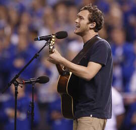 Phillip Phillips, a Georgian like Buster Posey, sings the national anthem.