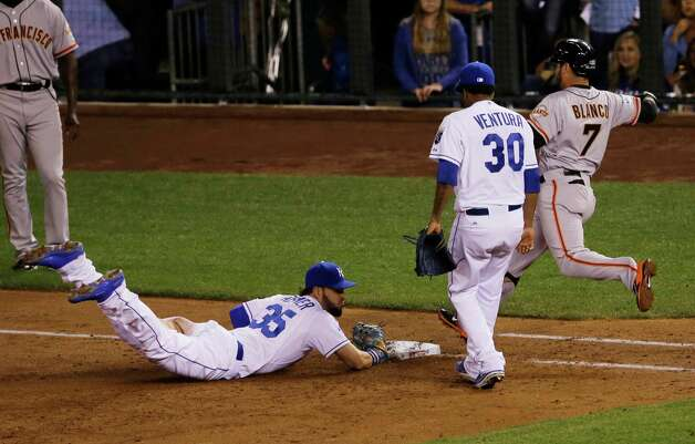 Kansas City Royals' Eric Hosmer (35) dives to first to beat San Francisco Giants' Gregor Blanco to the bag for an out during the third inning of Game 2 of baseball's World Series Wednesday, Oct. 22, 2014, in Kansas City, Mo. (AP Photo/Orlin Wagner)  ORG XMIT: WS343 Photo: Orlin Wagner / AP