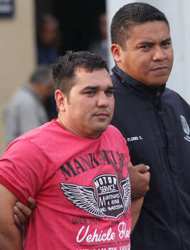 Juan Manuel Rodriguez a leader of Gulf Cartel, wearing red shirt, is shown to the press by the Mexican Authorities in Mexico City, Sunday, May 25, 2014. An official for the U.S. government tells The Associated Press that Rodriguez was the Gulf CartelÆs commander along the Rio Grande and was competing for control of the gangÆs operations in all of Tamaulipas state. (AP Photo/Luis Barron Tinajero) Photo: Luis Barron Tinajero, Associated Press / AP
