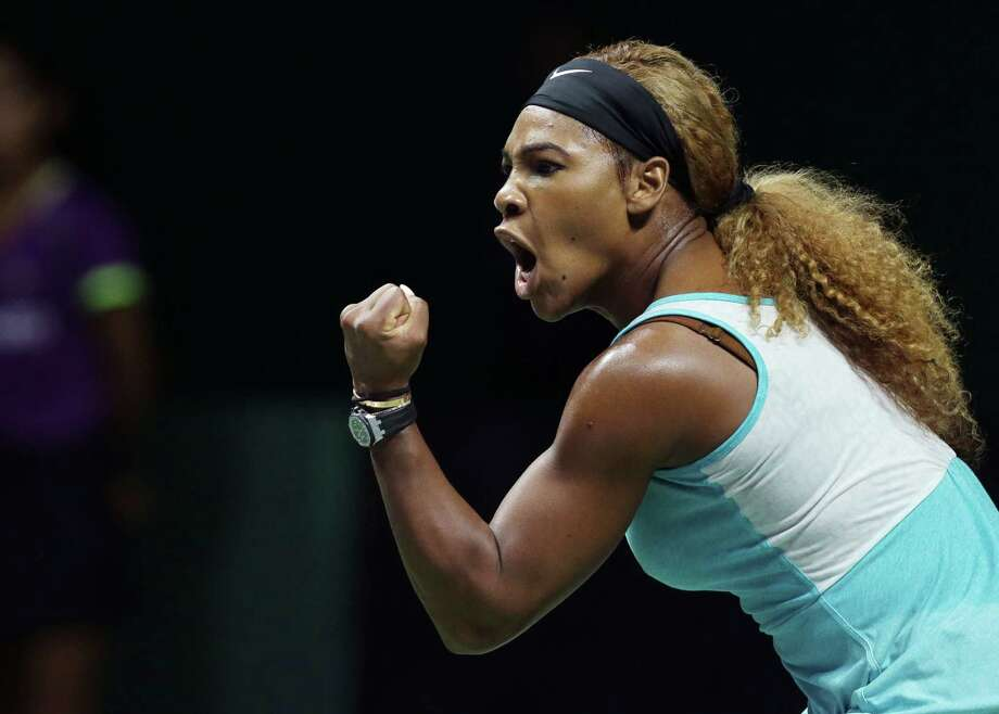 Serena Williams of the U.S. reacts during her singles match against Romania's Simona Halep at the WTA tennis finals in Singapore,Wednesday, Oct. 22, 2014. (AP Photo/Mark Baker) Photo: Mark Baker / Associated Press / AP