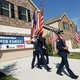 """A color guard opens a ceremony to present Staff Sgt. Travis Palmer and his family their new home on Wednesday, Oct. 22, 2014, in Tomball. """"This is perfect,"""" Sgt. Palmer said. """"I can't ask for another single thing. This is home."""""""