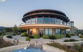 From the outside, all curves and glass.  Photos: Estately/MLS