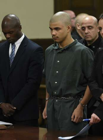 Gabriel Vega, 18, is arraigned in Rensselaer County Court where an indictment was unsealed, accusing him of first- and second-degree murder, arson and other offenses for allegedly killing his 19-year-old ex-girlfriend and then setting fire to her Lansingburgh. At left is attorney William Little. (Skip Dickstein / Times Union)