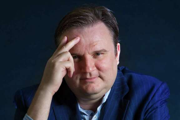 Daryl Morey, the general manager of the Houston Rockets is an avid chess player. Morey also shares his interest for chess with the community through the Clutch City Checkmate Challenge teaching about the strategic similarities between chess and basketball. Monday, Sept. 15, 2014, in Houston.