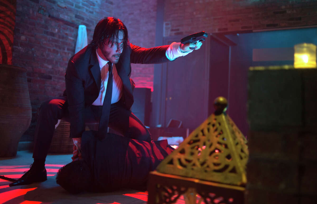 """Keanu Reeves as the title character in """"John Wick,"""" whose wife and dog are killed so he takes bloody vengeance. There's plenty of death in the action drama directed by Chad Stahelski."""