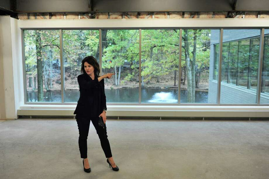 CBRE Director of Project Management Deborah Catalano shows off the second floor workspace with a view of the duck pond during the re-opening of Greenwich Office Park in Greenwich, Conn. Thursday, Oct. 23, 2014.  The 425,000-square-foot, nine building complex recently underwent a $13 million capital improvement campaign that resulted in upgrades to infrastructure, common areas and amenities. Photo: Tyler Sizemore / Greenwich Time