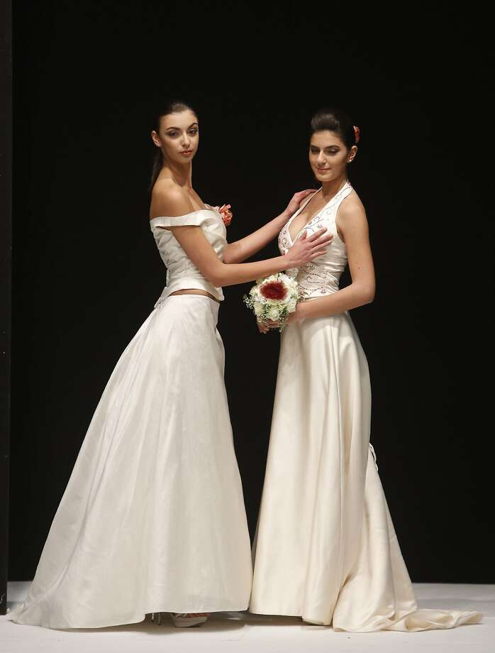 "GAY WEDDING STYLE: Models show designs for same-sex couples during ""The Rainbow Wedding Fashion Show"" in Rome. Former prime minister Silvio Berlusconi is pushing for the legalization of civil unions between gays and lesbians in Italy, but not same-sex marriage. Photo: Domenico Stinellis, Associated Press"