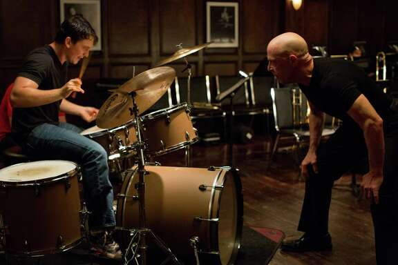 "Miles Teller, left, stars as tormented music student Andrew opposite J.K. Simmons as Mr. Fletcher in ""Whiplash."""