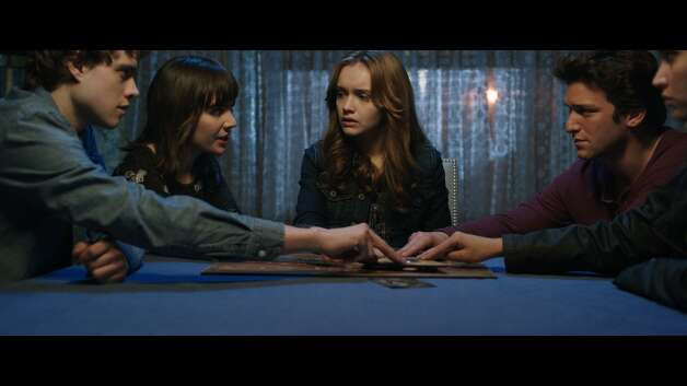"""Ouija""IMDb: 4.6/10Review by Mick LaSalle: 'Ouija' tries to hide predictability by raising a racket1-and-a-half starsAt a certain point in ""Ouija,"" a terrible dread seizes the audience. This dread takes the form of a realization, and the realization is that somebody is trying to sell you a Ouija board. What's more, they're employing a peculiar marketing strategy, or at least one that might sound peculiar to someone who knows nothing of human nature: Buy this. It will kill you. Photo: Universal Pictures / ONLINE_YES"
