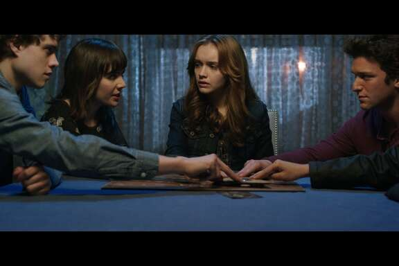 "Douglas Smith, from left, Ana Coto, Olivia Cooke, Daren Kagasoff and Bianca Santos star in ""Ouija."""
