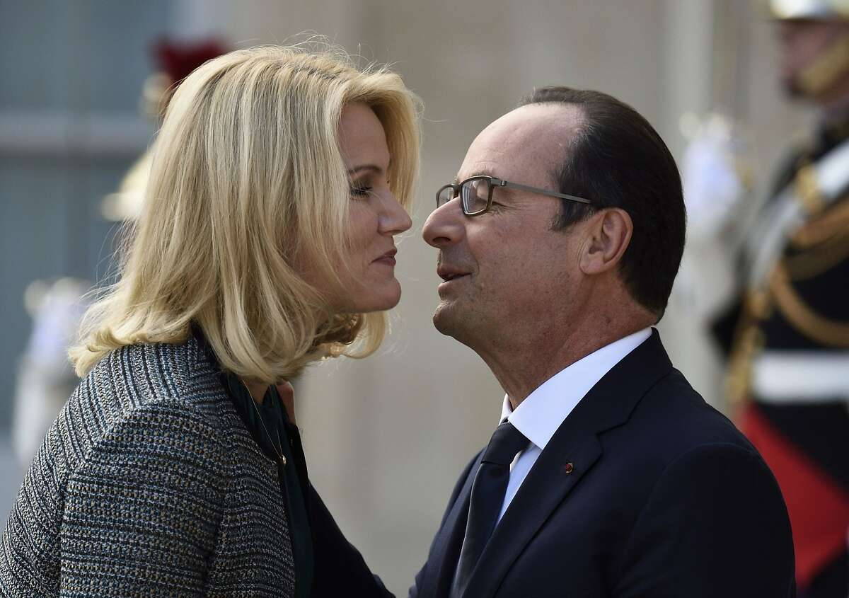 UNLIKE PUTIN, I ONLY INVADE YOUR PERSONAL SPACE: French President and noted ladies man Francois Hollande greets Danish Prime Minister Helle Thorning-Schmidt upon her arrival at the Elysee Palace in Paris.