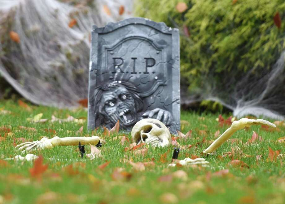 A decorative skelteton escapes from its grave in front of a house decorated for Halloween in Greenwich, Conn. Thursday, Oct. 23, 2014. Photo: Tyler Sizemore / Greenwich Time