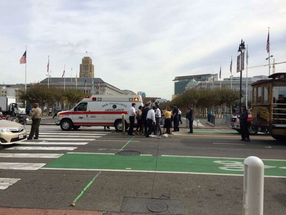 "A pedestrian, Priscila ""Precy"" Moreto, was hit and killed by a tourist trolley in front of San Francisco's City Hall Thursday morning. Photo: Heather Knight / ONLINE_YES"