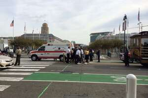 S.F. worker run over by tourist trolly outside City Hall - Photo