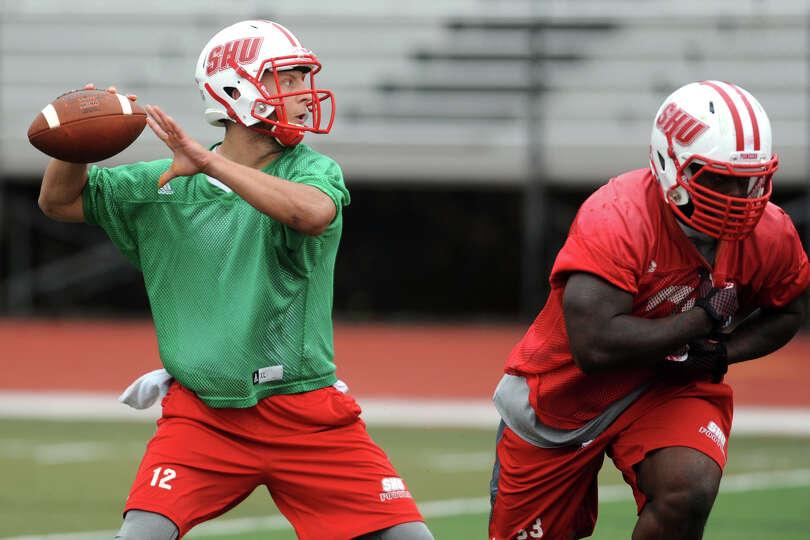 Sacred Heart University quarterback RJ Noel, a junior, passes the ball during football practice in F