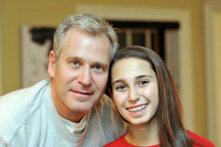 Zoe Butchen, a 14-year-old Ridgefield girl has started a fundraising campaign using Taylor SwiftâÄôs  hit song, âÄúShake it Off,âÄù to raise money for ParkinsonâÄôs disease, which her father Jeff was diagnosed with last year Photo: Contributed Photo / The News-Times Contributed