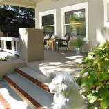 A covered front porch offers a shaded space to observe the neighborhood.