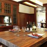 The dining room includes built-in display cabinets.