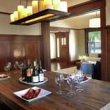 Tall wainscoting and a hardwood floor are features of the dining room.