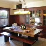 Antique latches, bead board backing and leaded glass windows dominate the dining room's cabinetry.