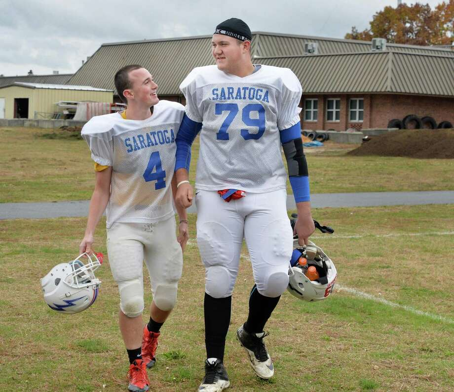 6-foot-7, 310-pound Saratoga senior lineman #79 Griffin Clancy, right, walks with team mate #4 Billy Barber during practice Wednesday Oct. 22, 2014, in Saratoga Springs, NY.   (John Carl D'Annibale / Times Union) Photo: John Carl D'Annibale / 00029166A