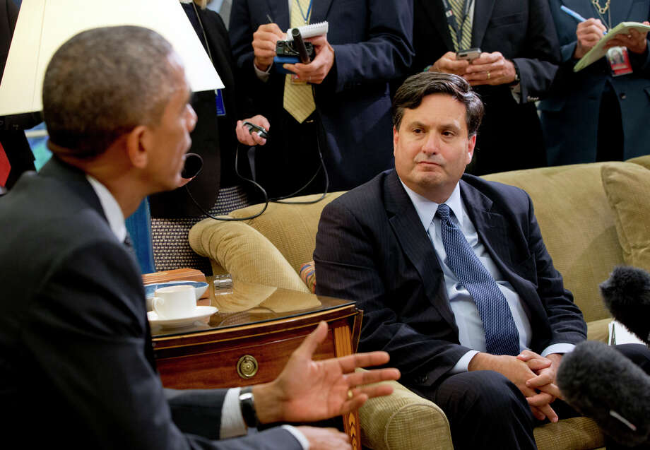 President Obama and his Ebola coordinator Ron Klain meet in the Oval Office to discuss the federal government's plans to deal with the outbreak of the virus as reporters take notes Wednesday. Photo: Jacquelyn Martin / Associated Press / AP