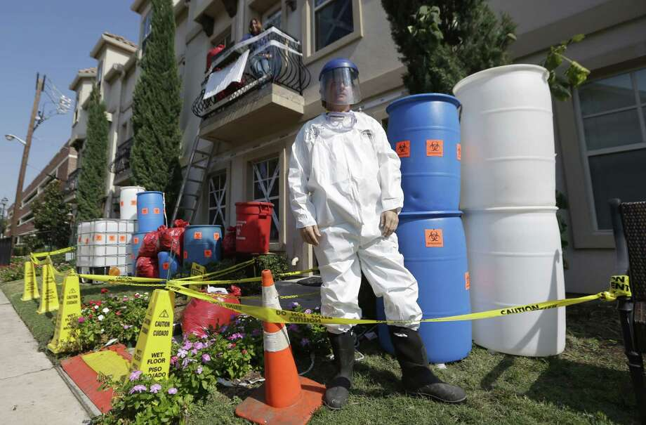 Homeowner James Faulk poses in front of an Ebola-themed Halloween display he made at his townhome in the University Park section of Dallas, Thursday, Oct. 23, 2014.  According to Faulk, he is just trying to get people to smile and enjoy Halloween. Photo: LM Otero / Associated Press / AP