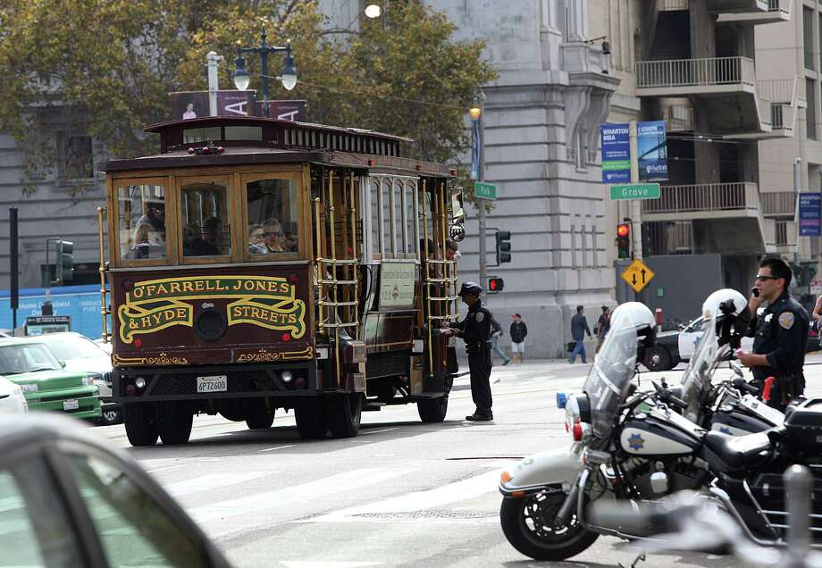 """Police investigate a tour bus from Classic Cable Car Charters which hit and killed Priscila """"Precy"""" Moretoon the Polk street side of city hall about 11:30am in San Francisco, Calif., on Thursday, October 23, 2014. Photo: Liz Hafalia / The Chronicle / ONLINE_YES"""