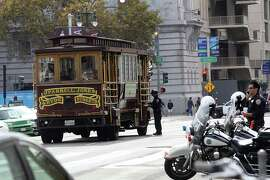 "Police investigate a tour bus from Classic Cable Car Charters which hit and killed Priscila ""Precy"" Moreto on the Polk street side of city hall about 11:30am in San Francisco, Calif., on Thursday, October 23, 2014."