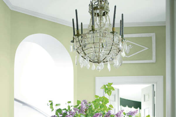 """Guilford Green  Benjamin Moore has made its big announcement: The company's 2015 Color of the Year is Guilford Green (HC-116), which creative director Ellen O'Neill calls """"a neutral that's natural."""" The silvery shade of green is the centerpiece of Benjamin Moore's color trend story for 2015, a palette of 23 shades of green, blue, blush and berry designed to mixed and matched.    In this photo:  Walls, Guilford Green; Trim and Stairway Wall, Chantilly Lace;  benjaminmoore.com       15 Effortlessly Beautiful DIY Fall Centerpieces   9 Fun Fall Party Treats   6 Fresh Fall Items for Your Home   20 Inspiring DIY Projects   17 Crazy-Delicious Recipes Served in Mason Jars   8 Color Rules To Follow For A Brighter, Happier Home"""