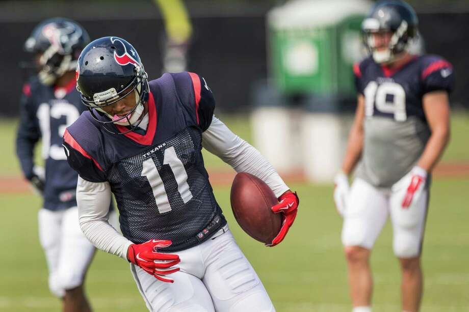 Houston Texans wide receiver DeVier Posey runs upfield after making a catch during practice at the Methodist Training Center Thursday, Oct. 23, 2014, in Houston. Photo: Brett Coomer, Houston Chronicle / © 2014  Houston Chronicle