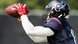 Houston Texans wide receiver DeVier Posey makes a catch during practice at the Methodist Training Center Thursday, Oct. 23, 2014, in Houston.