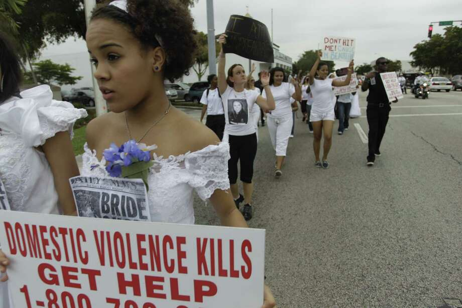 In this Feb. 11, 2011 file photo, more than 300 people participate in Barry University's first ever College Brides Walk, with many walking 7.5 miles in bridal gowns to bring awareness of domestic and dating violence. According to the National Survey on Teen Relationships and Intimate Violence, which is federally funded, a majority of boys and girls describe themselves as both victims and perpetrators of abusive dating behavior. Photo: Pat Carter / Associated Press / AP