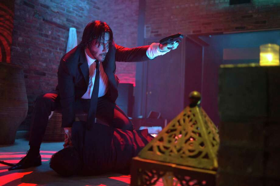 "This photo released by Lionsgate shows Keanu Reeves as John Wick in a scene from the film, ""John Wick.""  (AP Photo/Lionsgate, David Lee) ORG XMIT: CAET146 Photo: David Lee / Lionsgate"