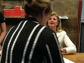 Arianna Huffington signs books at the QuickBooks Connect conference in San Jose.