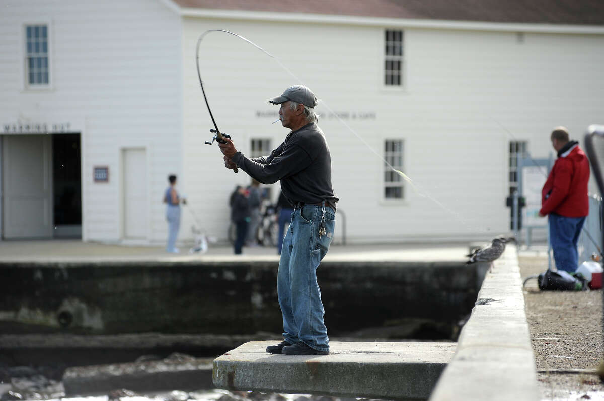 Anglers fish off Torpedo Wharf at Crissy Field in San Francisco on Oct. 22, 2014.