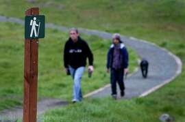 Tom Scott (left), Toshi Katayama and his dog Kinkuro hike on Philosopher's Way, a 2.7 mile loop trail that was officially dedicated at McLaren Park, in San Francisco, Calif. on Saturday, Jan. 5, 2013.