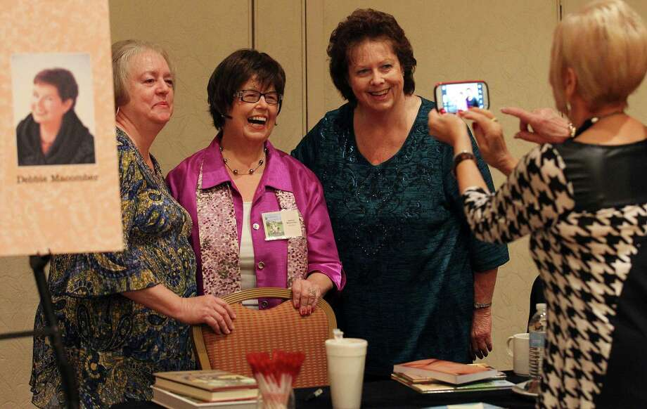 Author Debbie Macomber (center) poses for a photo with Linda McDonald (left) and Linda Stevens (right) at the 23rd Annual San Antonio Express-News Book & Author luncheon at the Marriott Rivercenter on Thursday, Oct. 23, 2014. Proceeds from the event benefit the Cancer Therapy & Research Center (CTRC) Phase I Clinical Research Program. Photo: Kin Man Hui, San Antonio Express-News / ©2014 San Antonio Express-News